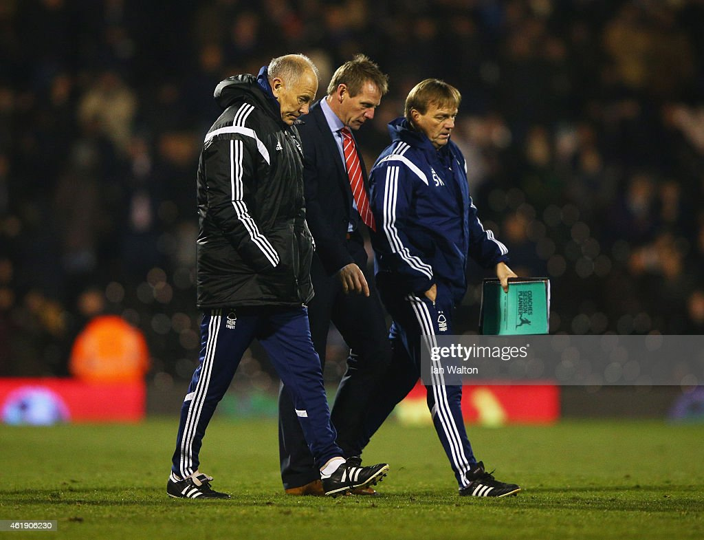 Stuart Pearce manager of Nottingham Forest (C) looks dejected at half time alongside first team coach Brian Eastick (L) and assistant manager Steve Wigley (R) during the Sky Bet Championship match between Fulham and Nottingham Forest at Craven Cottage on January 21, 2015 in London, England.