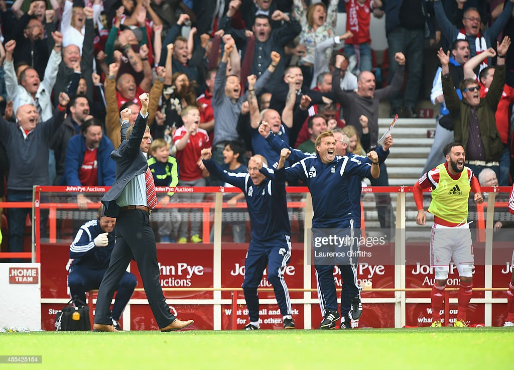 Stuart Pearce of Nottingham Forest celebrates his sides goal during the Sky Bet Championship match between Nottingham Forest and Derby County at City Ground on September 14, 2014 in Nottingham, England.