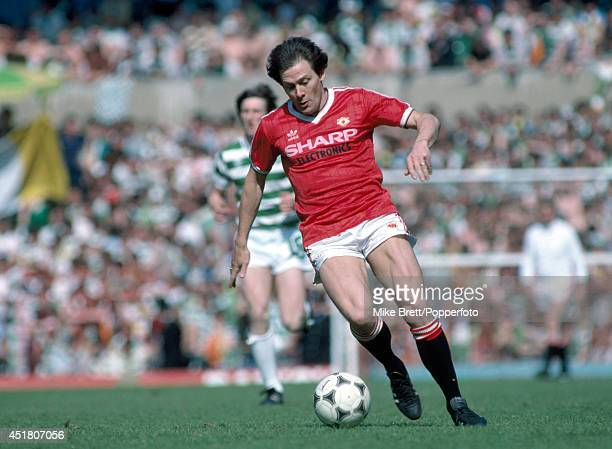 Stuart Pearson in action for Manchester United during his guest appearance in a Testimonial match for Sir Matt Busby at Old Trafford in Manchester on...
