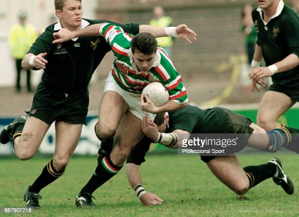 Stuart Potter of Leicester Tigers breaks the tackles of Dean Ryan and Graham Childs of Wasps during a Pilkington Cup SemiFinal rugby union match on...