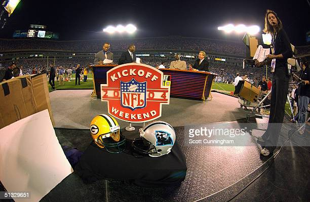 Stuart Scott Tom Jackson Michael Irvin and Ron Jaworski prepare to broadcast on the ESPN set before the game between the Green Bay Packers and the...