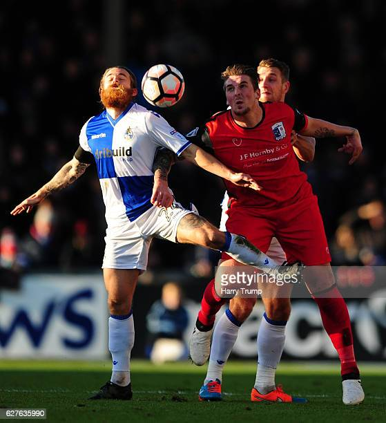 Stuart Sinclair of Bristol Rovers is tackled by Liam Hughes of Barrow FC during the Emirates FA Cup Second Round match between Bristol Rovers and...