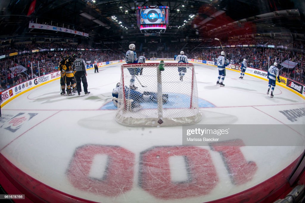 Stuart Skinner #74 of Swift Current Broncos lies on the ice in net as the Hamilton Bulldogs celebrate the game winning goal in third period at the Brandt Centre on May 21, 2018 in Regina, Canada.