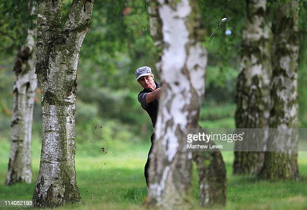 Stuart Smith plays from behind the trees on the 2nd hole during the first day of the Senior PGA Professional Championships at the Northamptonshire...