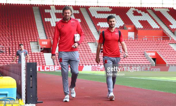 Stuart Taylor and Shane Long of Southampton arrive prior to the preseason friendly between Southampton FC and Sevilla at St Mary's Stadium on August...