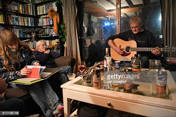 Stuart Taylor Penny Grear Sheila Grear Davie Wilson and Jim Grear play music and enjoy a drink at a late night gathering on October 2 2016 in Foula...