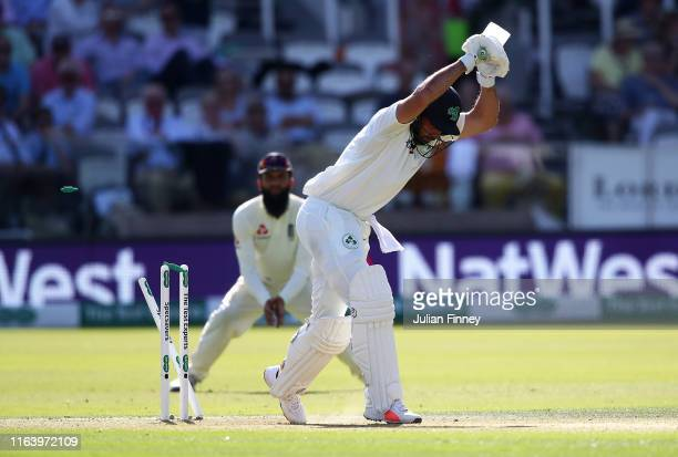 Stuart Thompson of Ireland is bowled out by Stuart Broad of England during day one of the Specsavers Test Match between England and Ireland at Lord's...