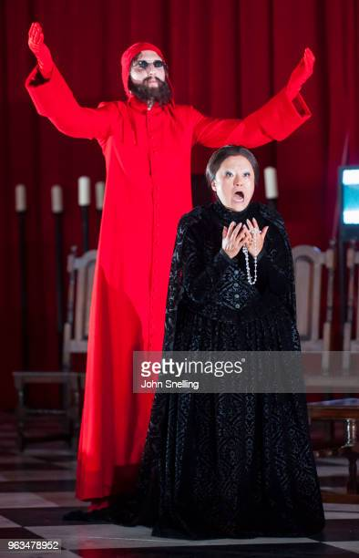 Stuart Thorn as Red Preist and Sen Guo as Queen of the Night perform on stage in a production of Die Zauberflote by Wolfgang Amadeus Mozart at...