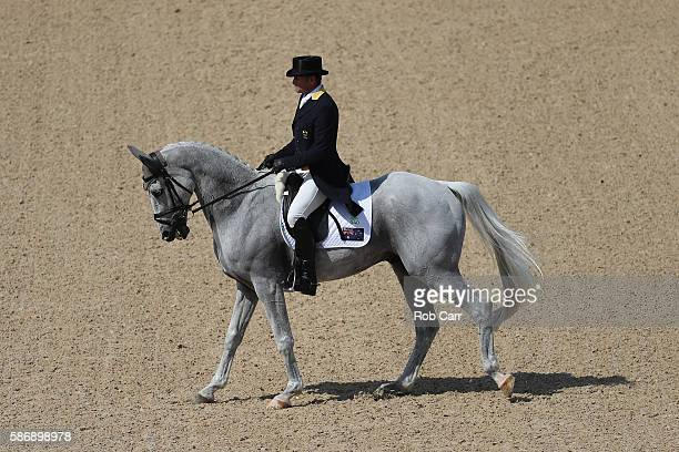Stuart Tinney of Australia riding Pluto Mio competes in the Eventing Team Dressage event during equestrian on Day 2 of the Rio 2016 Olympic Games at...