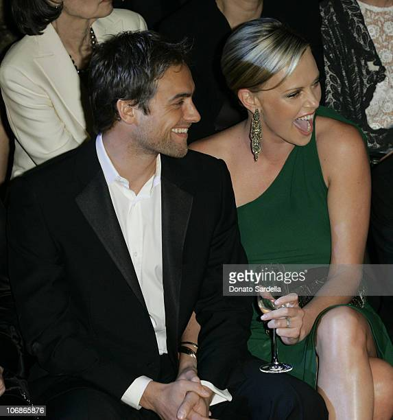 Stuart Townsend and Charlize Theron during Gucci Spring 2006 Fashion Show to Benefit Children's Action Network and Westside Children's Center Inside...