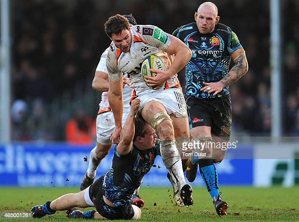 Stuart Townsend of Exeter Chiefs tackles Tyler Ardron of Ospreys during the LV= Cup match between Exeter Chiefs and Ospreys at Sandy Park on January...