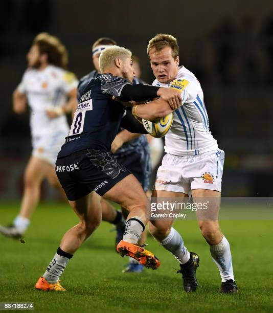Stuart Townsend of Exeter is tackled by James O'Connor of Sale during the Aviva Premiership match between Sale Sharks and Exeter Chiefs at AJ Bell...