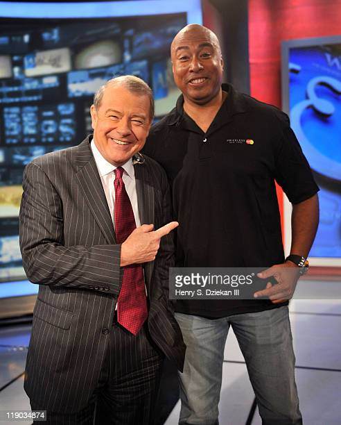 Stuart Varney and former MLB player and musician Bernie Williams tapes an episode of 'FOX Friends' at FOX Studios on July 14 2011 in New York City