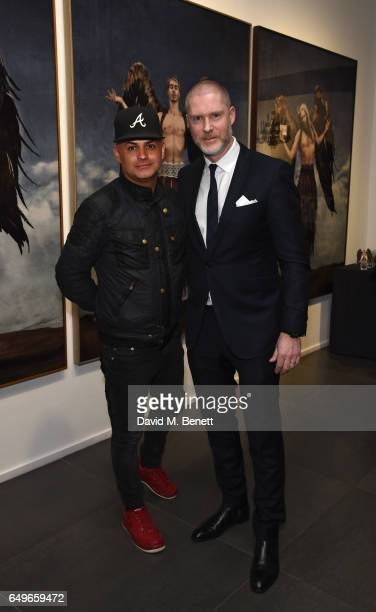 Stuart Watts and JeanDavid Malat attend a private view of artist Gerard Rancinan's new exhibition 'The Destiny Of Men' at Opera Gallery on March 8...