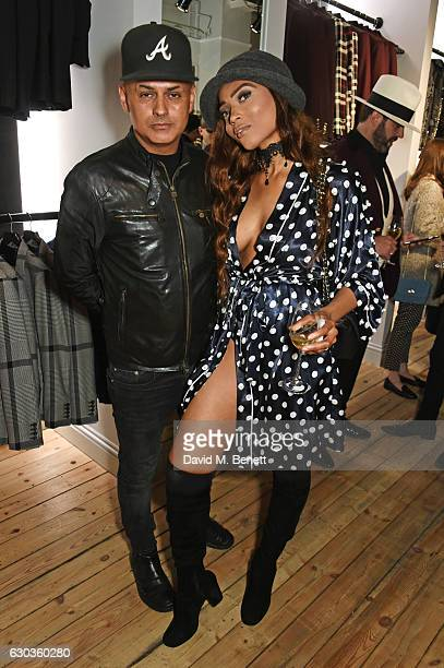 Stuart Watts and Kadian Noble attend the opening of the Joshua Kane London flagship store on December 21 2016 in London England