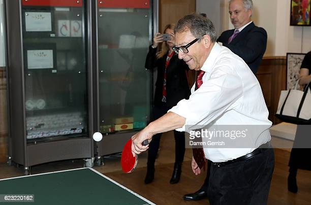 Stuart Weitzman plays pingpong during a private dinner to celebrate the opening of the Stuart Weitzman London Flagship Store at the Royal Academy of...