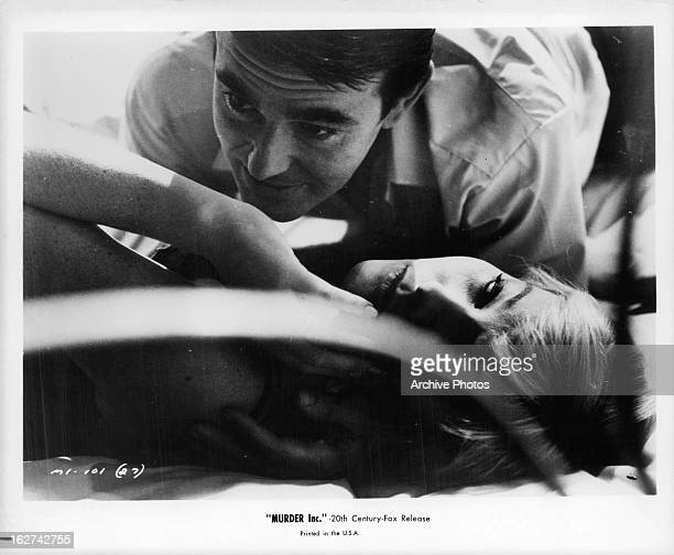 Stuart Whitman crawls over May Britt in a scene from the film 'Murder Inc' 1960