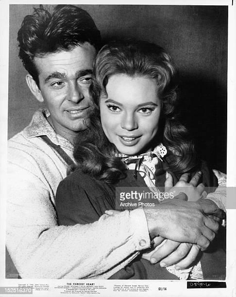 Stuart Whitman embracing Juliet Prowse in a scene from the film 'The Fiercest Heart' 1961