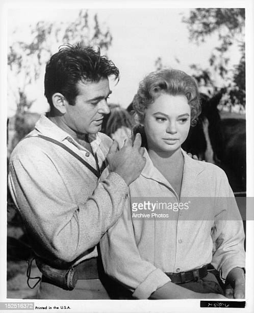 Stuart Whitman getting close to Juliet Prowse in a scene from the film 'The Fiercest Heart' 1961