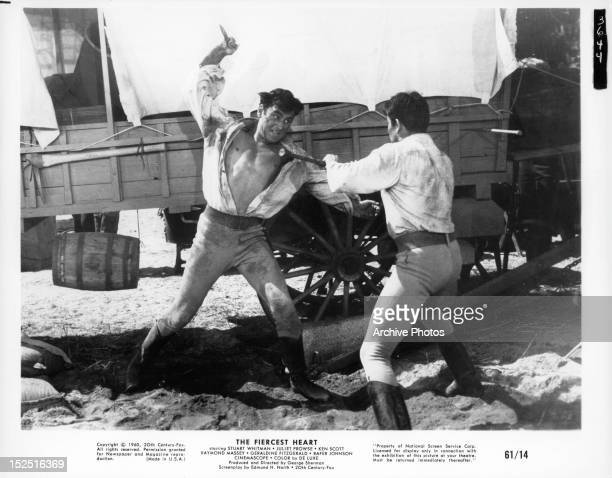 Stuart Whitman in knife fight with man in a scene from the film 'The Fiercest Heart' 1961