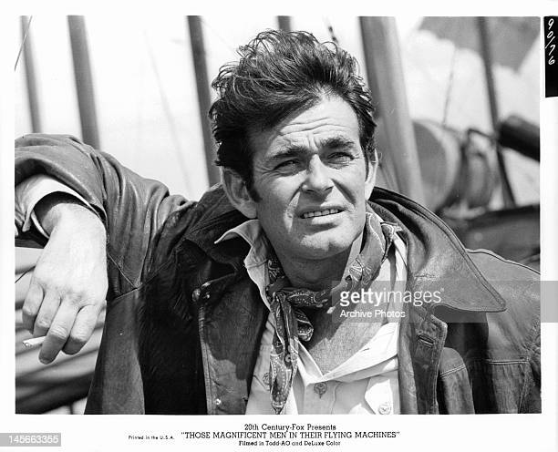 Stuart Whitman leaning against plane in a scene from the film 'Those Magnificent Men In Their Flying Machines Or How I Flew From London To Paris In...