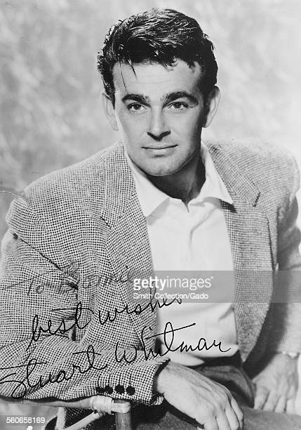 Stuart Whitman signed headshot sitting on a director's chair and staring at the camera 1954