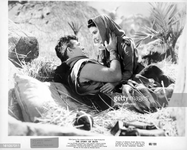 Stuart Whitman softly touching Viveca Lindfors as they stare lovely into one an others eyes in a scene from the film 'The Story Of Ruth' 1960