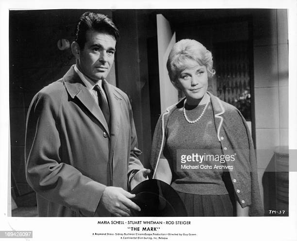 Stuart Whitman standing with Maria Schell in a scene from the film 'The Mark' 1961