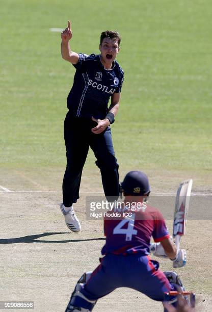 Stuart Whittingham of Scotland celebrates taking the wicket of Dilip Nath of Nepal during the ICC Cricket World Cup Qualifier between Scotland v...