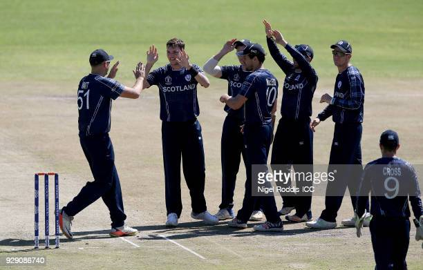 Stuart Whittingham of Scotland celebrates with teamates after taking the wicket of Dipendra Airee of Nepal during the ICC Cricket World Cup Qualifier...