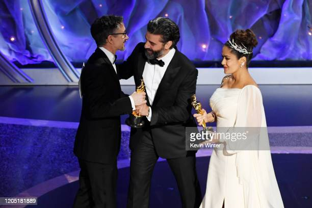 Stuart Wilson accepts the Best Sound Mixing award for '1917' from Oscar Isaac and Salma Hayek Pinault onstage during the 92nd Annual Academy Awards...