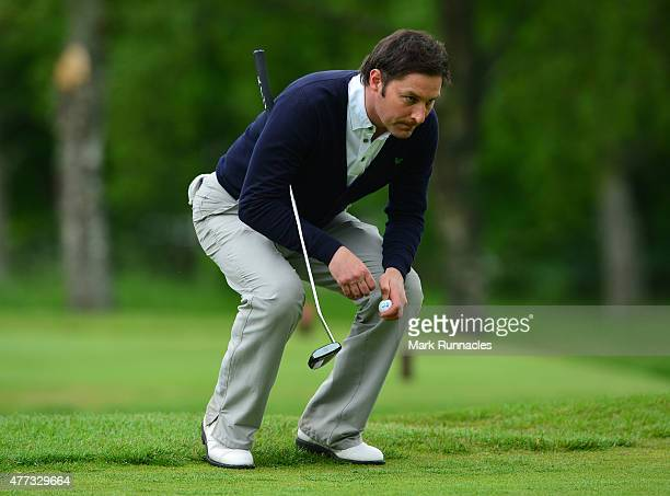 Stuart Wilson of Portlethen Golf Club looks for the line of his putt on the 15th green during the Lombard Trophy - Scottish Qualifier at Crieff Golf...