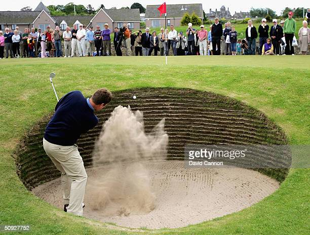 Stuart Wilson of Scotland, escapes from the 'Road Hole' bunker at the 17th during the final of the Amateur Championsip on the Old Course, on June 5,...
