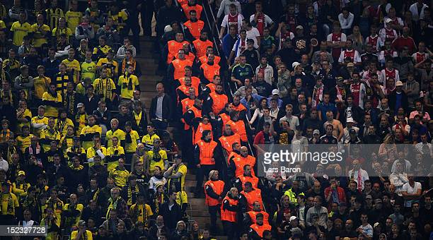 Stuarts are seen between Dortmund and Ajax fans during the UEFA Champions League group D match between Borussia Dortmund and Ajax Amsterdam at Signal...