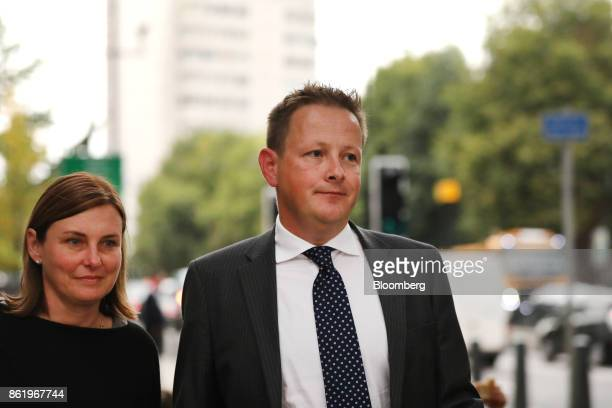 Stuart Scott former head of currency trading for Europe at HSBC Holdings Plc right departs Westminster Magistrates' Court in London UK on Monday Oct...