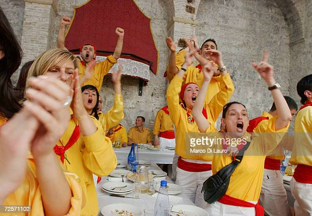 StUbaldo Ceraioli celebrate in one of their taverna prior to the Corsa dei Ceri on May 15 2004 in Gubbio 208 km northeast of Rome Italy Gubbio's Race...