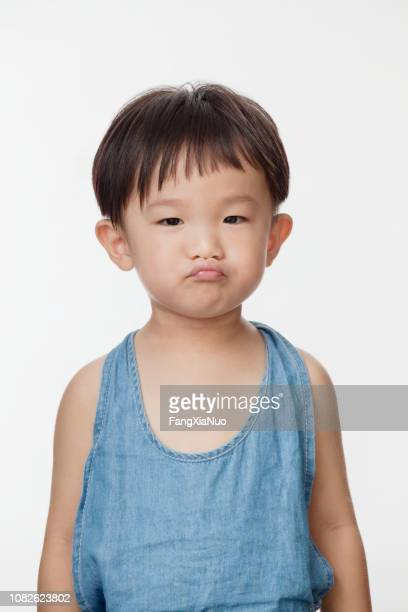 stubborn chinese boy - stubborn stock pictures, royalty-free photos & images