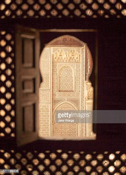 stucco work seen through window in a madrasa, school, meknes, morocco - jake warga stock pictures, royalty-free photos & images