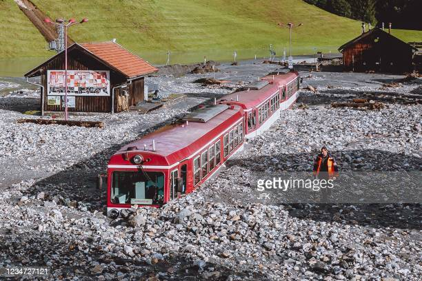 Stucked train after flooding is pictured in Wald im Pinzgau near Salzburg, Austria, on August 17, 2021. - Storms have battered large parts of Austria...