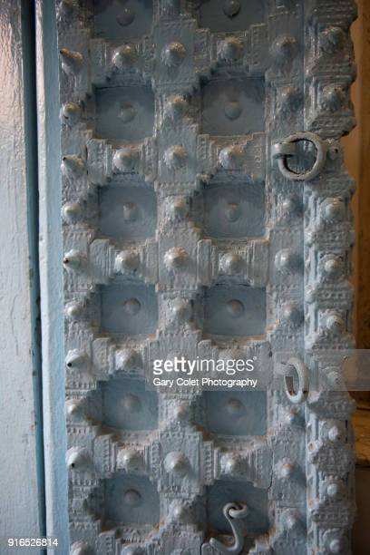 studded delhi door - gary colet stock pictures, royalty-free photos & images