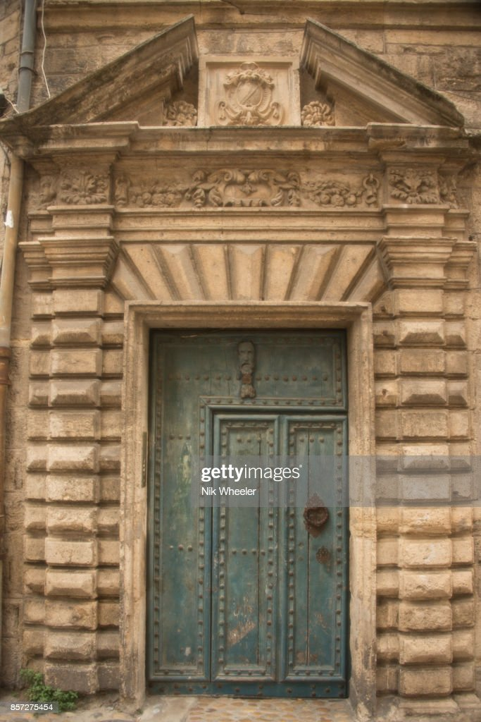 Studded Wooden Doorway With Carved Stone Frame In Street In Pezenas ...