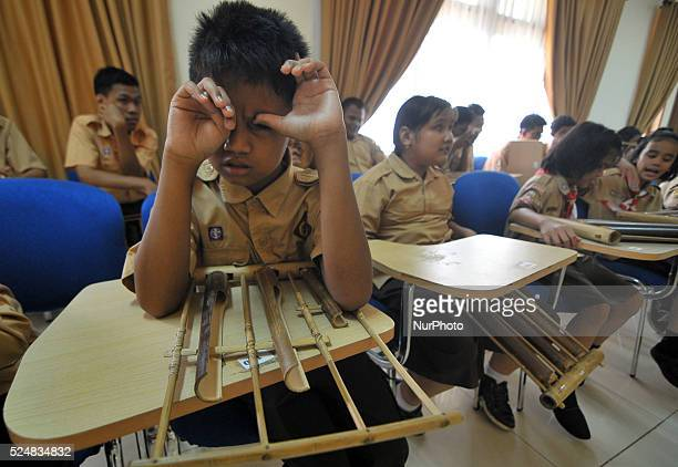 Studens with Angklung Indonesian tradisional music toolsTo mark the internatiional day of people with Disabilities SLBA Pembina School in cilandak...
