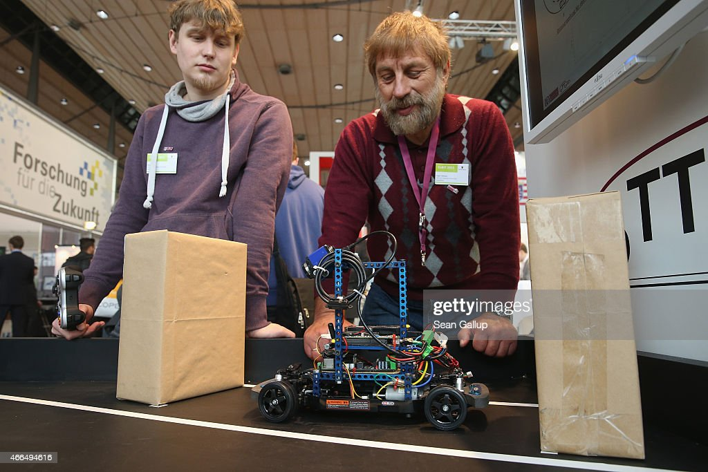 A student a professor from the University of Magdeburg watch an OttoCar robotic car they developed park itself at the 2015 CeBIT technology trade fair on March 16, 2015 in Hanover, Germany. China is this year's CeBIT partner. CeBIT is the world's largest tech fair and will be open from March 16 through March 20.