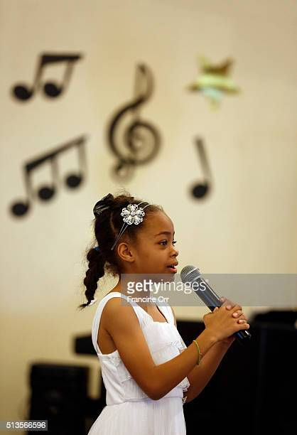 Student Aaliyah AllenWilson sings at Children of Promise Preparatory Academy in Inglewood CA March 3 2016 The school was honoring their former...