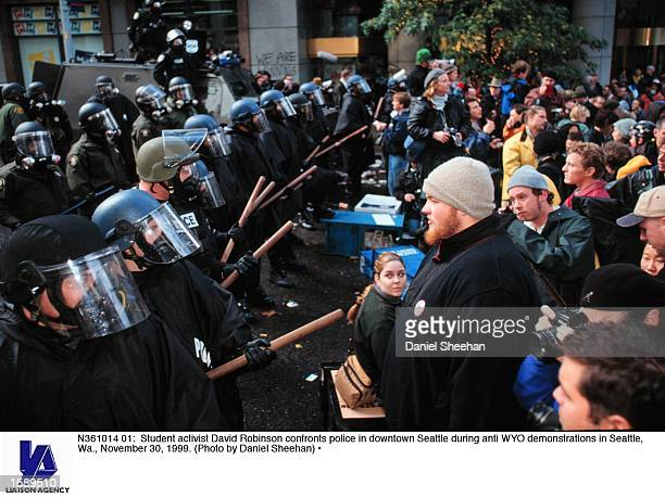 Student activist David Robinson confronts police in downtown Seattle during anti WYO demonstrations in Seattle Wa November 30 1999