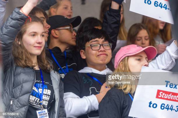 Student activist get emotional at the sound of Bob Dylan's classic 'The times are changing' performed by Portugal The Man during the March for Our...