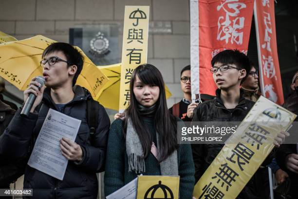 Student activist Joshua Wong and other students display pro-democracy placards outside the Wanchai police station in Hong Kong on January 16, 2015....