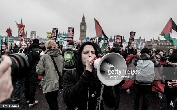 Student activist uses a loudspeaker to address crowds during a protest organised by the National Union of Students in London, United Kingdom, 21...