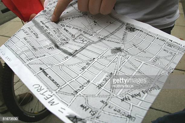 Student activists from American University in Washington DC and other activists from Indiana check their 'action map' downtown 27 September 2002 for...