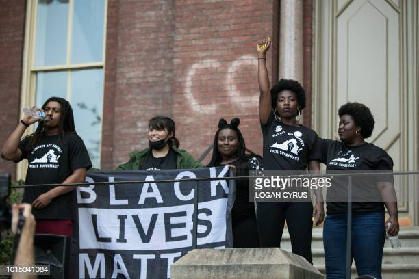 Student activists get ready to address the crowd during a rally on the campus of The University of Virginia one-year after the violent white...